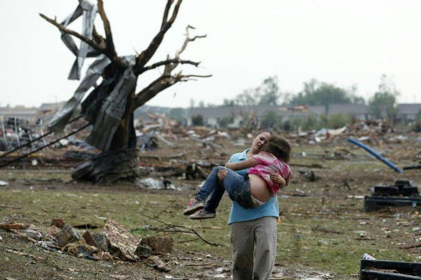 woman carries child in Moore Oklahoma